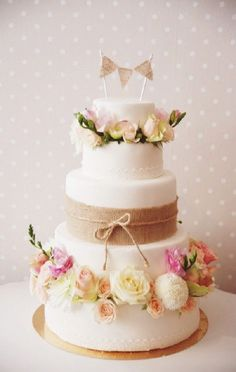 garden burlap wedding cake with pastel flowers