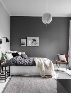 Love the dark grey wall used in this bedroom
