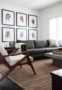 Nice living room design with framed gallery wall, grey sofa and mid-century armchair