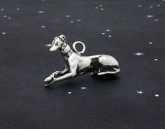 """""""Graceful Repose"""" sterling silver reclining greyhound charm by featheredgems for $30.00"""
