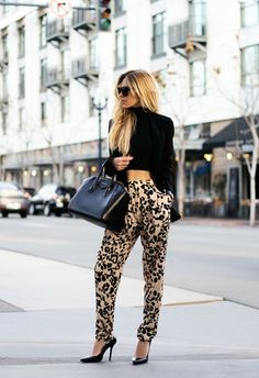 Consider teaming a black velvet jacket with khaki leopard silk pajama pants to create a chic, glamorous look. Elevate your getup with black leather pumps.  Shop this look for $131:  http://lookastic.com/women/looks/pumps-pajama-pants-tote-bag-sunglasses-cropped-top-blazer/4368  — Black Leather Pumps  — Khaki Leopard Silk Pajama Pants  — Black Leather Tote Bag  — Black Sunglasses  — Black Cropped Top  — Black Velvet Blazer