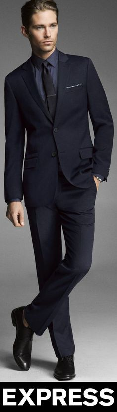 """Express's """"Stretch Wool Photographer Suit"""" in Navy, retails at $326. -Euro/Slim jacket (36R) featuring a narrow notched lapel, single vented back. Two-button front, four-button sleeve detail. Flap welt pockets, welt ticket and chest pockets. Fully lined, two interior buttoned pockets. -Suit pants featuring Slim fit, straight leg, sits below waist. Hidden hook and button closure with zip fly. Deep slant pockets, back welt pockets with buttons. (Materials: Polyester/Wool/Elastane)"""