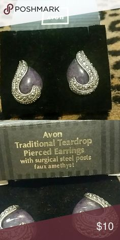 Avon Pierced Earrings Vintage Avon traditional teardrop earrings in faux amethyst and marcasite.  Worn maybe once or twice...like new.  Still in original box.  They are more purple than picture shows but not a bright purple.  Almost a marbled look. Avon Jewelry Earrings