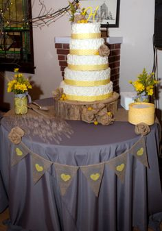 Grey and Yellow Wedding banner and love the cake!! And wood! This is like every thing in one. How cute