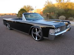 """1965 Lincoln Continental Convertible -   Perhaps one of the most iconic """"gangster"""" cars out of the 60's."""