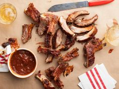 """According to the Neelys, """"These ribs will blow you away. The smoke and indirect heat leave you with deliciously tender ribs while the cola packs a punch of unexpected sweetness."""""""