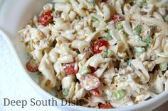 Chicken Pasta Salad - made with a homemade Ranch style vinegar dressing, short cut pasta, cooked chicken, Vidalia onion, celery, cheese, bacon, peas and tomatoes.
