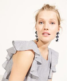 J.Crew women's ruffle top in stripe and sequin drop earrings.
