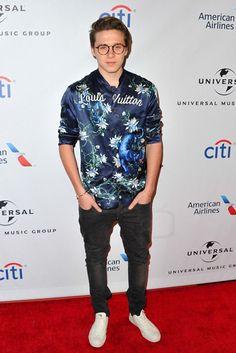 Brooklyn Beckham wearing  Louis Vuitton SS16 Floral Printed Silk Pyjama Shirt, Cartier Juste Un Clou Nail Bracelet