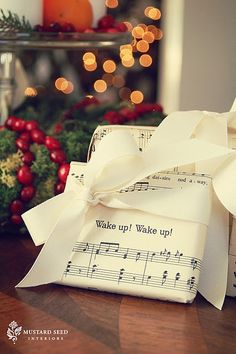Music sheet wrapping paper.  With Bow. Perfect for Gift for Grandson David.