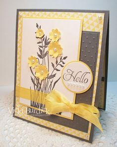 Grey and yellow paper along with white pearls add a dash of elegance to these sunny flowers.  Handmade Hello card