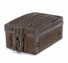 Iron Missal Box, French, c.late 15th cent. rectangular, slightly domed lid, pierced ironwork tracery over a wood core, decorative hasps and lock on front, cloth lined interior    27.5 cm; 10 3/4 in wide