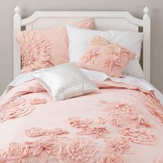 Combine the delicate, elegant look of fresh flowers with the soft, comfy feel of our bedding and you get our Fresh Cut Duvet Cover. Each flower is intricately appliquéd onto the duvet cover's surface for added texture. Add our Swiss Dot Sheet Set and Fresh Cut Pillow for a refreshingly coordinated look.