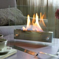 Looking for a candle alternative? Try this mobile fireplace for portable winter warmth! #home #design