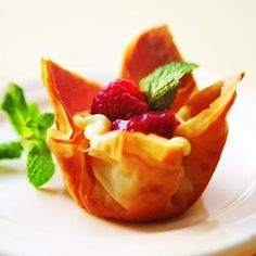 Fill crisp phyllo cups with orange-scented custard, then crimson berry-rhubarb sauce. It's the ultimate sophisticated finale for spring dinner.