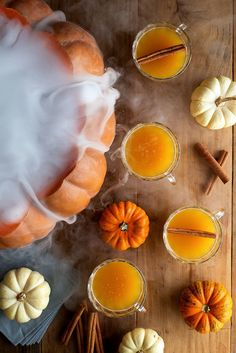 No punch bowl, no problem. Hollow out a large pumpkin, fill with a mixing bowl and pour in pumpkin punch. Add dry ice just before the party starts to create an extra spooky effect. Click through for the recipe and more Halloween cocktail ideas.