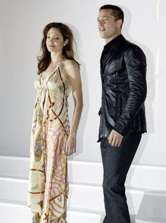 Angelina Jolie and Brad Pitt, dodging rumors of a romance, kept their distance as they promoted 'Mr. and Mrs. Smith' at ShoWest in Las Vegas in March 2005.