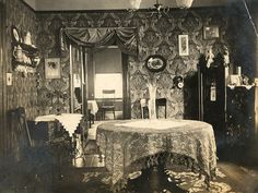 so love the covered table....large glass funeral vase...not to mention the wallpaper...