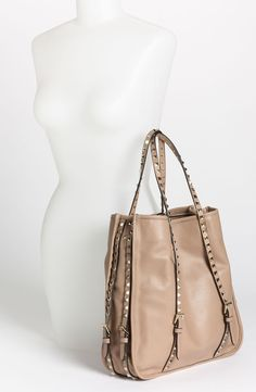 Free shipping and returns on Valentino 'Rockstud' Leather Shopper Tote at Nordstrom.com. A gilded logo highlights one side of a creamy leather shopper enhanced with shining studs for a fashion-forward finish.