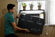 The Apartment Life: Sliding or magnetized covers incorporated into shelving or a credenza can hide ugly air conditioners. Window Ac Cover, Window Ac Unit, Hide Ac Units, Window Air Conditioner Cover, Ac Unit Cover, Buy Milk, Apartment Makeover, Decoration, The Unit