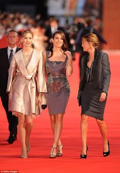Beatrice Borromeo (L) and Charlotte Casiraghi (C) attend the La Dolce Vita world restoration premiere during The 5th International Rome Film Festival at Auditorium Parco Della Musica  in Rome, Italy, and all look stunning for the occasion