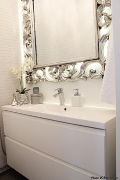 Home White Home -blog LOVE how the back of this mirror is illuminated by LED light!!