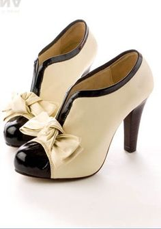 Elegant creme/black heels with bow.....very 1920s with modern twist!