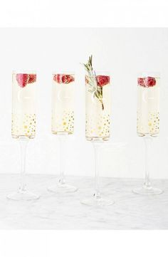 "This set of 4 handblown glass champagne flutes decorated with golden dots and personalized with an engraved letter for a personalised look are perfect for weddings or anniversary celebrations. Height: 10 1/2"" holds 8 oz."