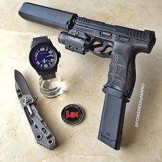 The Black Benjamin. Extended magazine, knife, watch and other nice friends for your handgun.