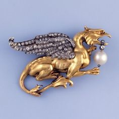 Photo by David Behl, © Janet Mavec and GIA-A muscular creature rippling with vitality, the griffin in this 19th-century French 18k gold brooch looks ready to defend the precious treasure it guards. Diamond-set wings and a natural pearl dangling from its mouth make this griffin as beautiful as it is fierce.