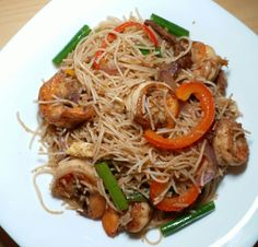 """The best Singapore Bee Hoon we've had was at a roadside hawker restaurant in Langkawi, Malaysia. The dish was full of fresh prawns and yummy fried pork or """"char siu"""". In this reci… Char Siu, Fried Pork, Prawn, The Dish, Japchae, Singapore, Fries, Healthy Eating, Restaurant"""