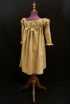 Cotton roller print child's dress, circa 1820.