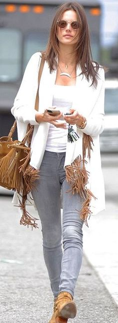 Who made  Alessandra Ambrosio's white fringe cardigan sweater, jewelry, tan suede boots, and beige handbag?