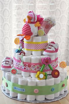 diaper cake. I make this for almost every baby shower I attend. They are so beautiful and truly fairly easy. It's best if you have cardboard and an extra hand to help you do the ribbon part.