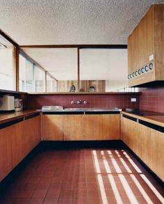 House Unknown. Australia. Photo by Michael Wee. Timber Kitchen, square tiles, terracotta floor tiles, timber joinery, timber benchtop.