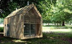 Mini green pre-fab home. I'd like to get one of these and plop it down in the woods by a lake and visit it on vacay.