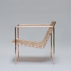 Rod+Weave Chair is handmade to order. Solid hex rod frame, powder coated in black or white. Natural vegetable oil tanned leather, woven seat and back. Leather will get darker over time.  Armrest height - 24