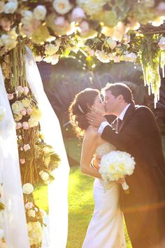 """Why We Love It: The beautiful flowers and lighting make this one of the most romantic photos we�ve seen yet! Why You Love It:�""""This is definitely our favorite! You can feel the love, and the flowers and lighting are gorgeous!""""��Paper Works and Events """"Really romantic!""""��� Diana E.�Photo Credit: Joan Allen Photo�"""