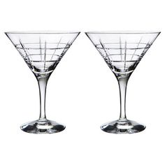 Set of two martini glasses with classic silhouettes.          Product: Set of 2 martini glasses Construction Material: