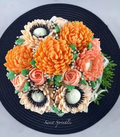 Caramel cake with buttercream frosting.. Adorned with buttercream flowers..