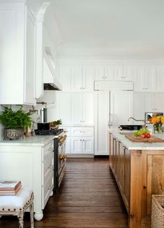 wood in kitchen. beautiful wide-plank floors. More versatile for us in an ashier gray-brown.