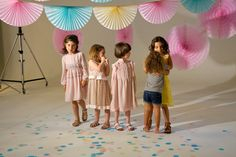 A quick hug from a younger sister at the Preen Mini fashion shoot for Spring 2016 season