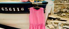 Pink dress on boat