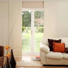 Vinyl sliding panels for back sliding glass door - good alternative to curtains or ugly vertical blinds.