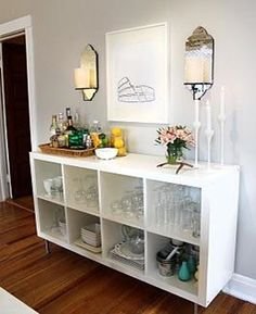 ikea shelving with legs instead of buffet in dining room? ikea shelving with legs instead of buffet in dining room? living room decor on a budget Find out more at the image link. Bar Deco, Ikea Expedit, Kallax Shelf, Expedit Bookcase, Ikea Shelves, Floating Shelves, Bookcase Bar, Cube Shelves, Expedit Regal