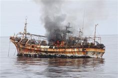 Derelict Japanese ship sunk by U.S. coast guard. It was lost during the tsunami last year.