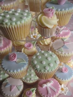 Cath Kidston inspired Cake & Cupcakes- clever use if cookie cutters on fondant icing!