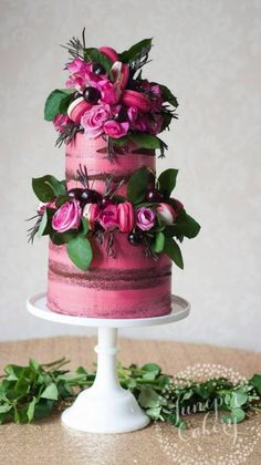 Featured Cake: Juniper Cakery; Lovely pink flower and macaron wedding cake