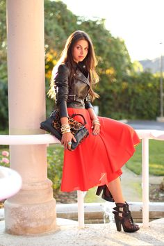 love how a leather jacket offsets a pretty dress