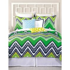 Get your chevr-on! The Trina Turk Tangier Stripe coverlet is bold and lively in both pattern and color. Trina Turk combines ornate and feminine patterns within the bold chevron design in a fresh color pallet of greens and yellows with a touch of navy and white to keep this coverlet modern, just like Trina Turk fashion. Quilted all the way through, this is great on its own for the top of the bed, or as a complement to your current bedding collections to add a plush texture. Complement the…